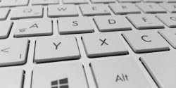 Close-up of white computer keyboard - Copy Trading